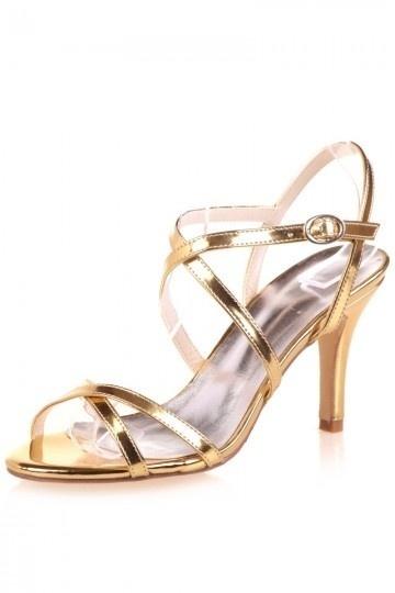 Les chaussures de demoiselle d'honneur dorées à talon pointu
